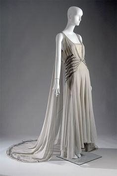 Smoke-grey chiffon court presentation gown with bead and rhinestone embellishment, by Madeleine Vionnet, French, 1938. Worn by Mrs. Potter Palmer II when she was presented to the Queen of England.