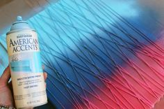 Wrap canvas with string. Spray paint with your choice of colors. Remove string. Tada! Art!