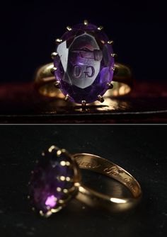 """1865 Amethyst Intaglio """"Go"""" Ring, 14K Gold. The face of the stone is carved with an intaglio that reads """"GO"""" along with the image of a pointing hand.   from eerie basin"""