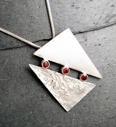 clever pendant, joining two pieces of sterling with tube settings