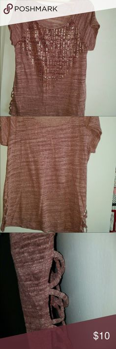 Rose colored top 🌹 Rose colored top with rose metallic colored embellishments. Like new. Cross cross cut out on the sides. Short sleeve. I do have a bulldog and try to remove any and all dog hairs from my items. Tag has been cut out. Tops Blouses