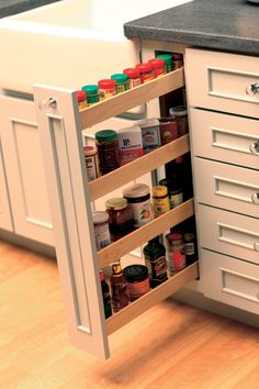 Small spaces offer surprising amount of spices storage with vertical pull-out spice rack cabinet (Dura Supreme Spice Rack Storage Solution).