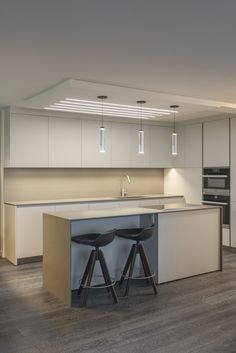 Several parallel lines of Pure Lighting's recessed TruLine .5A offer an intriguing appearance inside this #Chicago condo   TruLine .5A - by Pure Lighting #modernlighting #ledlighting