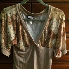 Pretty deep v-neck blouse w retro floral print. 3/4 sleeved deep v-neck blouse w brown/beige/white floral print.  Stretchy, silky and soft.  92% polyester/8% spandex.  Great condition. Zoey Beth Tops Blouses