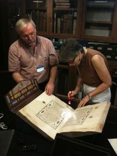 Abigail Quandt, Senior Conservator of Manuscripts at The Walters Art Museum, examines a Koran with Adam Gacek in the NEH project to digitize The Walters Art Museum's Islamic illuminated manuscripts
