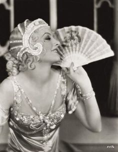1920s, My favorite decade of fashion. I love everything about the 1920's. I love the beautiful details in women's garments. And hair head pieces I love as well. In this picture I love the flapper's head piece and dress with the beaded details.