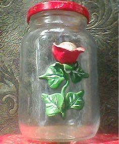 Reciclando vidros, criando arte em flores para decorar.