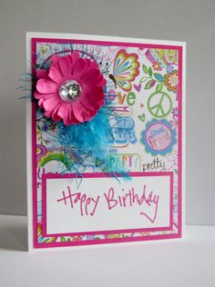 Spring handmade birthday card.  Pink paper flower, floral print and a feather!