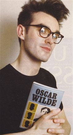 of course he's taken pictures with Oscar Wilde books