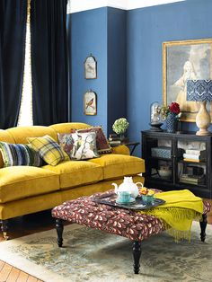 Walls: stiffkey blue by Farrow & Ball, sofa in House Velvet Turmeric from Sofa Workshop. Cabinet graham and green