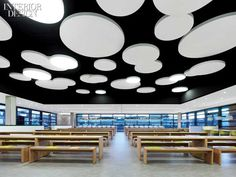 Firm: Dittel Architekten Project: Breuninger Kantine, Stuttgart, Germany. Standout: Juxtaposing shapes is the conceit in a department store's employee cafeteria, where custom oak tables and benches stand under a constellation of discs in gypsum board and acoustic plaster.