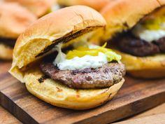 A gryo-spiced meat mixture is formed into little patties, grilled, and topped with tzatziki and pickled peperoncini for one tasty sandwich. So what if we broke a major burger rule in the process? Lamb Recipes, Greek Recipes, Diet Recipes, Healthy Recipes, Healthy Food, Gyro Burger Recipe, Burger Recipes, Greek Gyros, Spiced Beef