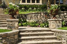 If you have a sloped yard, use retaining walls to add level spaces down the slope for beautiful plants and shrubs