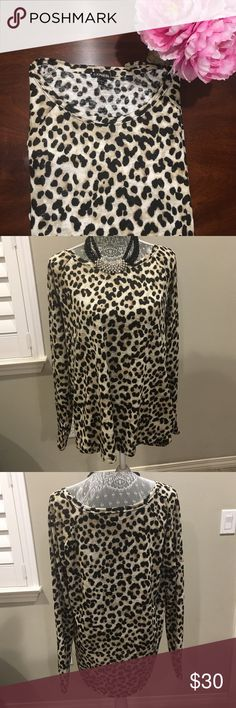 Cute Animal Print Blouse This cute animal print top is perfect for an evening or everyday wear! The length in the back is 28 inches and the length in the front is 26 inches. So it will cover your butt and matches well with leggings. The pit to pit measurement is 22 inches and so the top is a bit flowy. It comes in a size large, it's long sleeve, and it's made with 100% polyester! Let me know if you are interested Express Tops Blouses