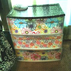 Clear plastic drawers. Used fabric and modge podge on the inside and on top.
