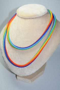 This is a great necklace, and a statement piece for sure. Bright, summer long harness around his neck in one or two turns. Or wrapped around the wrist time (about five depending on the arm) like a bracelet.  Hand-made from more beads. 7 colors of the rainbow, the symbol of the 7 chakras.  Colours: red, orange, yellow, green, blue, indigo, violet.  Length 42.5 inches (108 cm) Diameter 0.3 inches (7 mm)  This is the finished product  The color may differ slightly, depending on the settings of…