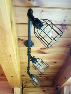 This listing is for a custom made-to-order Rustic Industrial Ceiling Track Light. This light is sturdy, industrial, and can be built to suit your needs. The bulbs shine down at a 45° angle from the bar and they can swivel 360°. OPTIONS: Use the variations menu above to create