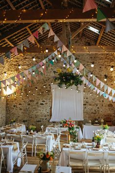 create a colorful and cheerful wedding venue with flag pennant banners, string lights and awesome wedding tables!