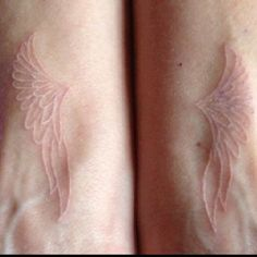 White ink angel wings tattoo. If I will ever get a tattoo, it will be similar to this one