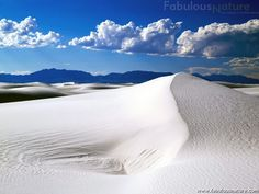 Bright blue sky & cottony clouds over White Sands National  Monument, New Mexico