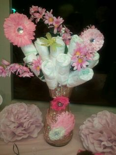 Diaper flower bouquet with hairbows for our baby shower! Soo cute!!!