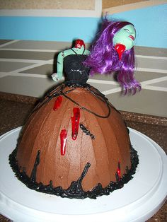 Zombie Barbie cake.....never seen such perfect use of a Barbie doll in my life!!!!
