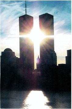 Stunning Silhouette of the World Trade Center Towers. Take notice the Sun created a cross.