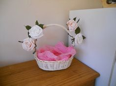 Confetti Cones in a wicker basket decorated with paper roses