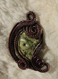 Nice little rain forest jasper.  It is also reversable, but from end to end.