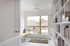 Pocket doors hide a home office and library.