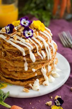 One of the best kinds of pancakes! Soft and fluffy carrot cake pancakes with a rich cream cheese topping. Perfect for Easter or any weekend morning!