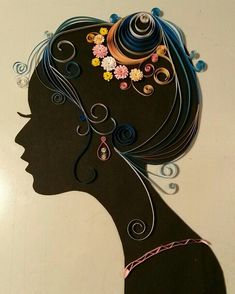 Paper quilling and black paper silhouette, finished off by putting it in a floating frame.