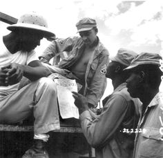 American troops in Burma reading President Truman's Proclamation of Victory in Europe, May 91945.