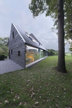Built by Barend Koolhaas in Almen, The Netherlands with date 2015. Images by Jeroen Musch. This small house in the countryside is designed around a long panoramic window with a view into the garden and the su...