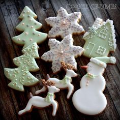 Pale Green & White with Gray and Peach Snowflake, Deer, Snowman and Snow-covered House Christmas Cookies Christmas Sugar Cookies, Christmas Sweets, Christmas Cooking, Noel Christmas, Holiday Cookies, Gingerbread Cookies, Christmas Cakes, Fancy Cookies, Iced Cookies
