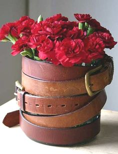 re-purposing old belts.-- Drape them around a vase and you have your own old west style cowboy vase