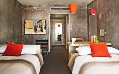 exposed, rough concrete walls and simple beds - cool hotel room (line hotel in LA's koreatown)