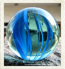 """Explored on Oct 2008 Have you ever play Marbles? This is the macro image of one of those marbles. In Urdu/Hindi, it is called """"Bantay"""" (بنٹے) Marbles For Sale, Marbles Images, Marble Price, Marble Board, Kind Of Blue, Glass Floats, Glass Marbles, Glass Paperweights, Glass Ball"""