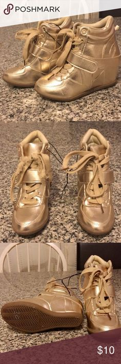 Cute Gold heel sneakers A pretty gold heeled sneaker, the shoelace of the right shoe was bit and pulled by dog. Easy to find new shoelaces . The shoes are brand new, in good condition. Has the strap in the middle. Size 2. Blue Suede Shoes  Shoes Sneakers