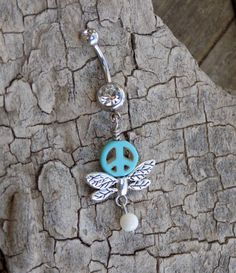 Energy Charged Turquoise Stone Peace Sign Wing Charm Navel Belly Button Ring with White Rivershell Accent by SPIRITUALTURTLE on Etsy  - Jewelry, Body Jewelry, Navel Ring, Belly Ring, Surgical Steel, Peace Sign, Wings, Angel, Dragonfly, Stone, Crystal, Turquoise, Reiki, Healing Energy, Healing Crystals, Blue, Shell, Hippie, Boho, Gypsy, Positive Energy, Good Vibes, Bright, Unique, Handmade, Small Business, Shop Small, Spiritual Turtle, Etsy,
