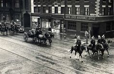 The state tour of Liverpool City ended in rain in August 1951 as the Lord Mayor of Liverpool, Alderman Vere Cotton) and the Lady Mayoress drive back to the Town Hall escorted by police riders in Scotland Road