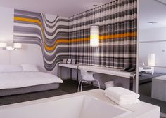 Bedroom with striped curtains and mural at The Standard Hotel downtown Los Angeles