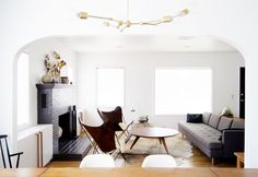 I love the all white walls and grey fireplace, never would have thought to go dark with the firelace