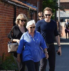 June 24: Taylor, Tom, and his mother Diana in Essex, England.