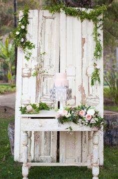 Love the feel of the vintage door, just needs a chandelier. Table has candlestick and candle