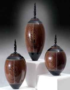 By woodturner Kim Blatt | Three of a kind - Ebony and Holly lidded vessels #wood
