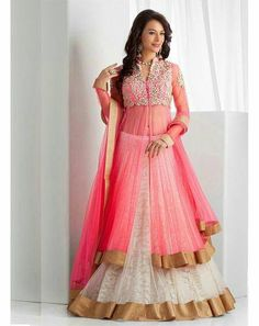 This beautiful Lehenga in light red and white has beautiful zari work on top. The fabric used in net and lining is satin. The jacket can be made in any color. Select your color when ordering.