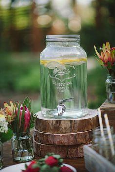 Beverage dispenser displayed on thin wood pieces. Diy Wedding Food, Wedding Reception, Wedding Recipe, Wedding Backyard, Table Wedding, Glass Dispenser, Drink Dispenser, Trendy Wedding, Perfect Wedding