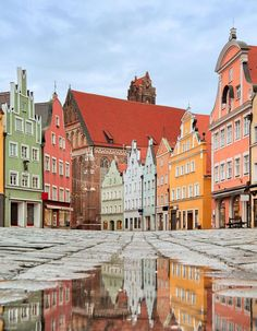 Italy Destinations – An Insiders Guide A street with colorful facades in Munich Italy Destinations, Scotland Destinations, Places Around The World, Travel Around The World, Around The Worlds, Germany Europe, Germany Travel, Munich Germany, Places To Travel