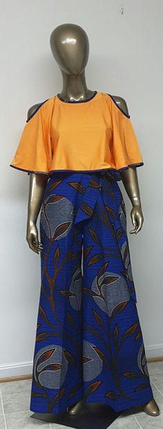 C'est un pantalon de Palazzo impression africain sans doublure. INCLUS : • Une paire de pantalon Palazzo Le modèle porte la taille 8 DÉTAILS : • Néerlandais en Wax Print. • Conseils d'entretien : Nettoyage à sec seulement. Pressé à froid Visitez ma boutique : https://www.etsy.com/shop/NanayahStudio EBJ TAILLES * US 2 – 33 buste - taille 24 pouces - hanches 34-35 pouces * US 4--34 buste - taille 25 pouces - hanches 36-37 pouces * US 6--35 buste - taille 26 pouces - han...